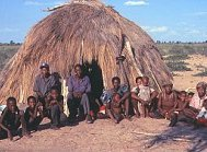 Bushmen in front of hut