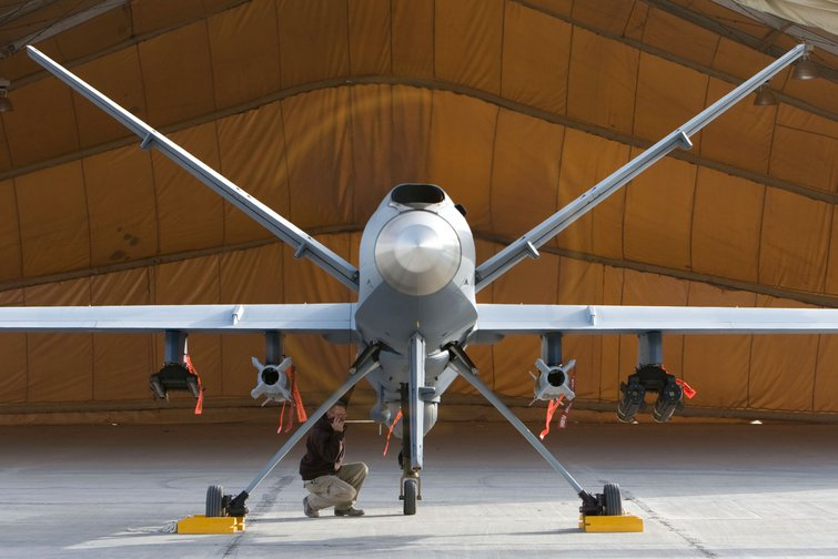 A maintenance Airman inspects an MQ-9 Reaper in Afghanistan