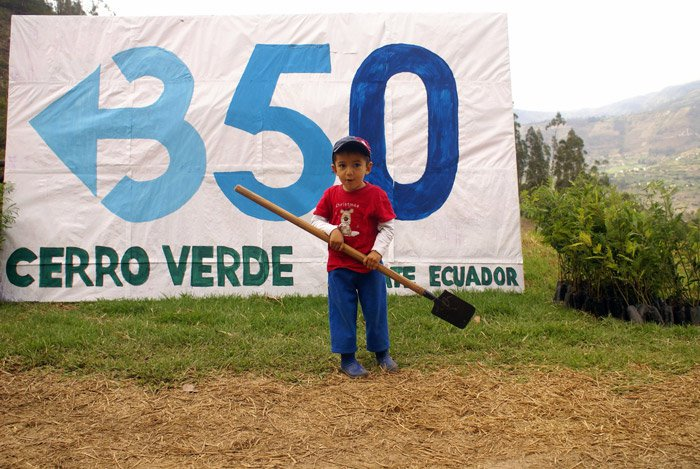 Boy next to cerro verde banner