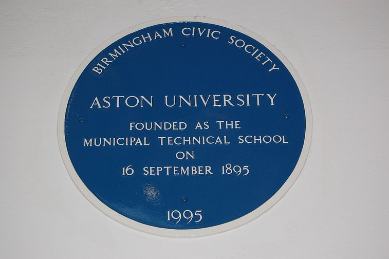 Blue plaque in the main building of Aston University, Birmingham, England.