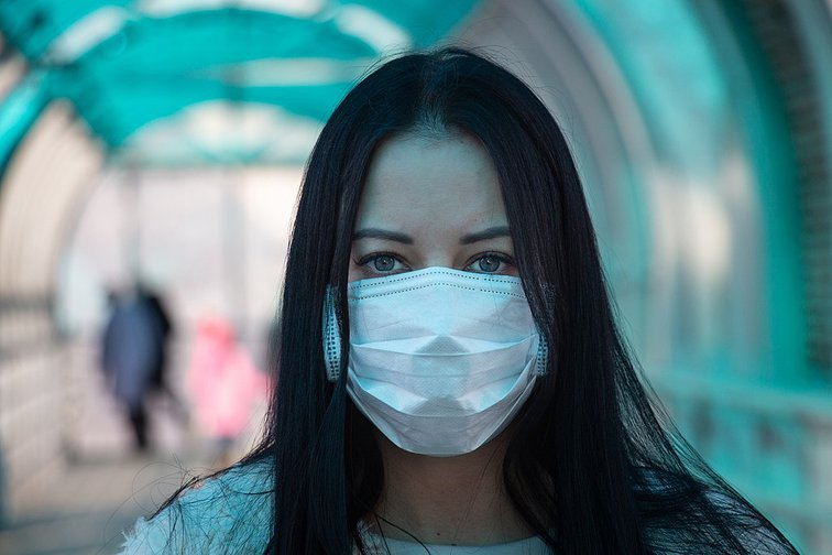 Girl in a medical mask on a Russian street.