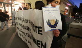 25 left-wing and kurdish activists demonstrate with banner and caricature of Gülen against a event about the Gülen Movement