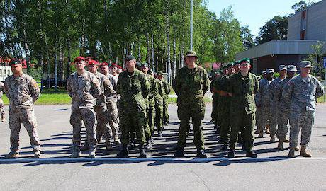 Members of the U.S, Latvian, Canadian, and Estonian Armies in Camp Adazi, Latvia.