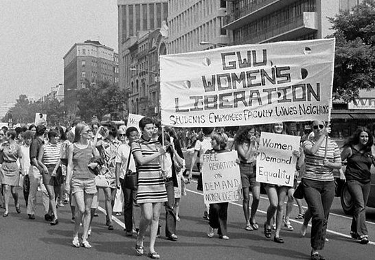 Women marching holding a banner in Washington DC, 1970