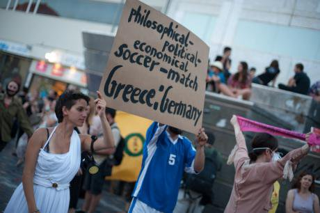 actors in a mock match between Germany and Greece.