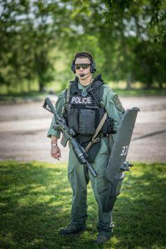 Not your friendly neighbourhood officer--a SWAT team member.