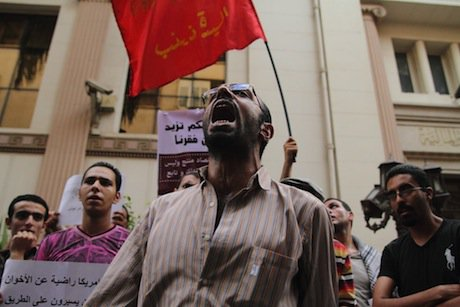 An anti-IMF protester in Cairo. Demotix/Mohamed Ali Eddin. All rights reserved.