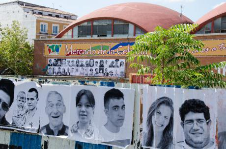Wall of Cebada market covered with 'Be the change' portraits, September 2012.