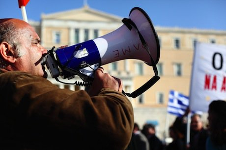 An anti-austerity protester in Athens. Demotix/Yiorgos Doukanaris. All rights reserved.
