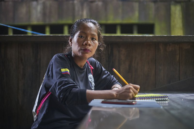 Gloria, one of the women who belongs to the Guardia Indígena Ambiental de San Martín de Amacayacu, takes notes during the conversation foreseeing a routine inspection in the Ticuna territory.