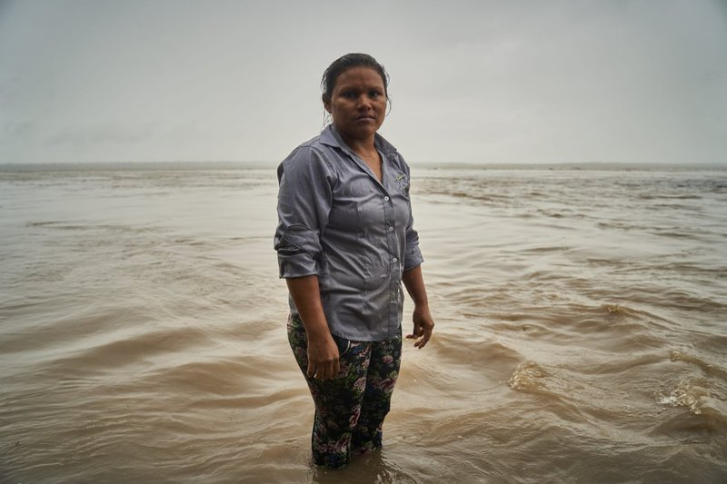 Lilia poses for a portrait on the Amazon River. Her path, like that of so many other indigenous women, has been of permanent fight and determination.