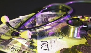 1633_1money_notes_stethoscope_budget_finance__J.jpg
