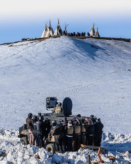 Protesters and the National Guard, Standing Rock, February 2017. Ryan Vizzions/Standing Rock Rising. All rights reserved.