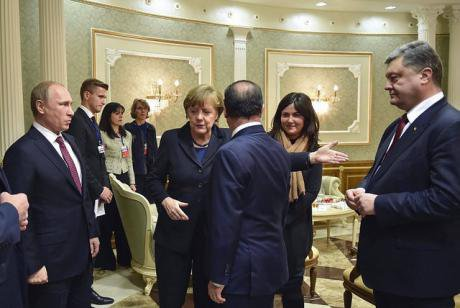 Putin, Merkel, Hollande and Poroschenko at the Minsk Summit 2015. flickr/Poggemann. Some rights reserved