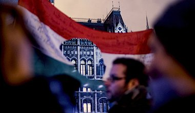 Anti-government demonstrators wave a cut-out Hungarian flag, the symbol of the 1956 Revolution, in front of the Hungarian parliament. Demotix/Peter Nemeth. All rights reserved.