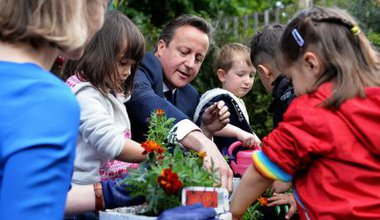 Prime Minister David Cameron visiting a nursery.