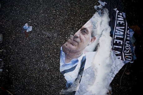 What remains of an electoral poster on the streets of Bologna. Demotix/Michele Lapini. All rights reserved.