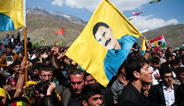 PKK supporters hold pictures of imprisoned leader Abdullah Öcalan during a celebration of the Kurdish New Year. Demotix/Pazhar Mohammad. All rights reserved.