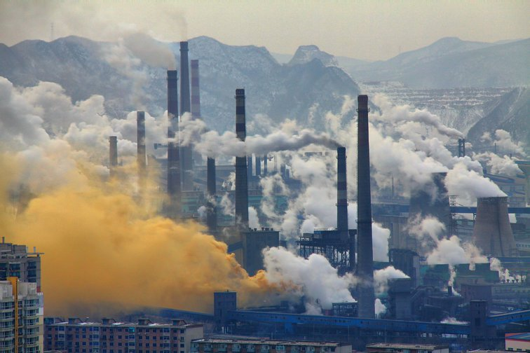 Smoke stacks from a steel plant in Benxi, China (2013).