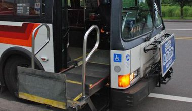 1992_Flxible_Metro_bus_with_wheelchair_lift_fully_raised_0.jpg