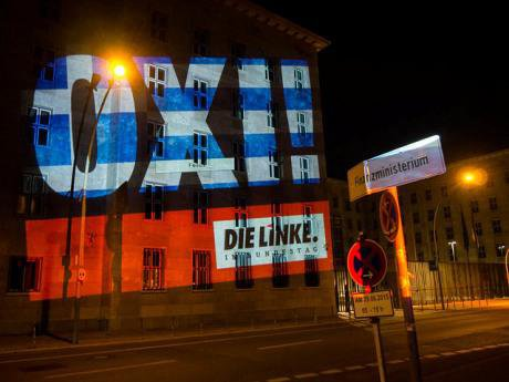 'OXI' projected onto the German Finance Ministry by Die Linke. Flickr/Fraktion die linke. Some rights reserved.