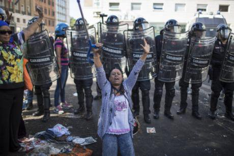 Women protest an eviction in Rome, August 2017.