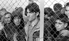 20101009_Arrested_refugees_immigrants_in_Fylakio_detention_center_Thrace_Evros_Greece_restored.jpg