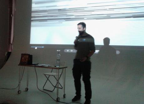 Orthodox activist Dmitry Enteo, bathed in the divine light of his projector screen.