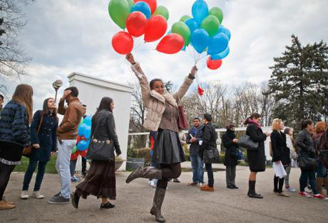 A girl with balloons in Roma flag colours, International Day of the Roma, Bucharest 2015