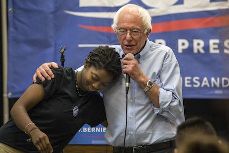 Bernie Sanders hugs a student on a campaign event at Creative Visions, September 27, 2015. Phil Roeder/Flickr. Some rights reser