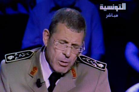 Tunisian General Rachid Ammar announces his resignation on TV, June, 2013.