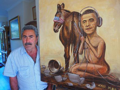 Political painter Kaya Mar with his new painting of US President Barack Obama eavesdropping on a blindfolded nation.