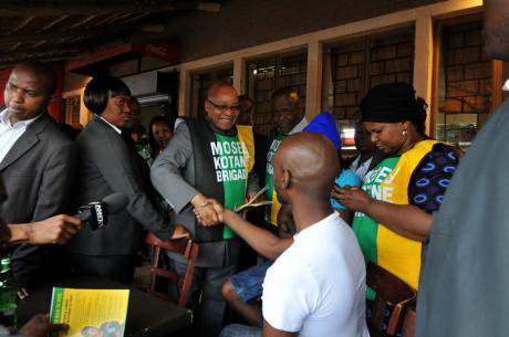 President Jacob Zuma greets patrons in the town of Katlehong, Johannesburg as he conducts an election campaign