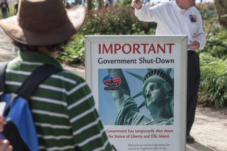 A sign warns of the temporary closure of the statue of liberty in New York City due to the government shutdown.