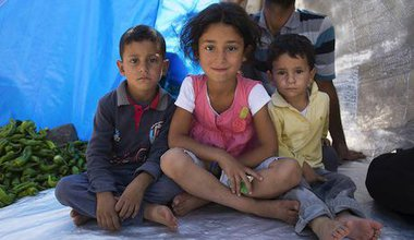 Syrian refugee children in a makeshift shelter. Demotix/Matthew Aslett. All rights reserved.