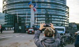 A woman taking a photo of the European Parliament building in Strasbourg, France | ifeelstock / Alamy Stock Photo. All rights reserved