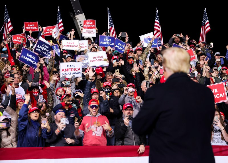 Trump greets supporters at a rally in Georgia in December.