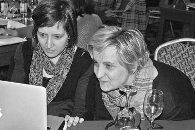 Two women look at a computer together