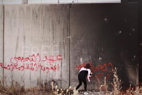 3. A girl tags the Israeli separation wall near Bil'in, in the West Bank. Photo Daniel Avelar copy.jpg