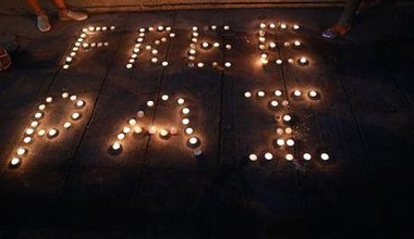 Candles at a protest against the detainment of activist Jatupat Boonpattararaksa.