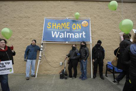 Protesters march on Walmart in Bellevue on Black Friday in 2013