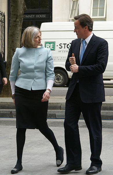 Prime Minister David Cameron is met by Theresa May on his first visit to the Home Office