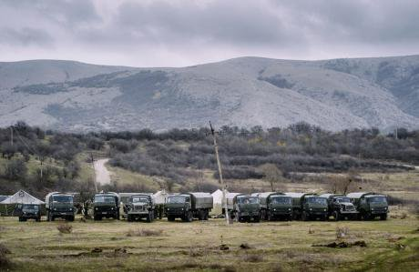 A line of Russian trucks preparing to move in Crimea.