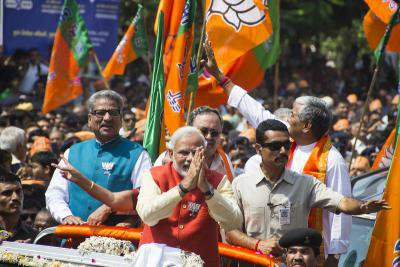 Surrounded by a crowd of supporters, Narendra Modi filed his nomination papers