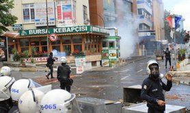 Turkish police fire tear gas on May day protesters, 2014.