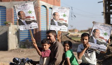 In Dirin village near Mansoura, a man with a motorcycle campaigns for Sisi
