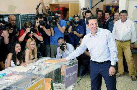 Syriza party leader Alexis Tsipras votes in 2014 European elections.