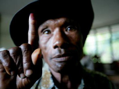 Early-morning voter showing inked finger in Dili,Timor-Leste.