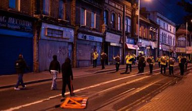 Standoff between police and rioters, Croydon, London, 2011.