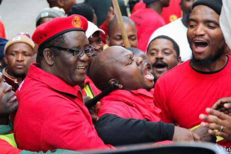 Numsa members on strike sing praise songs for Cosatu general secretary, 2014.